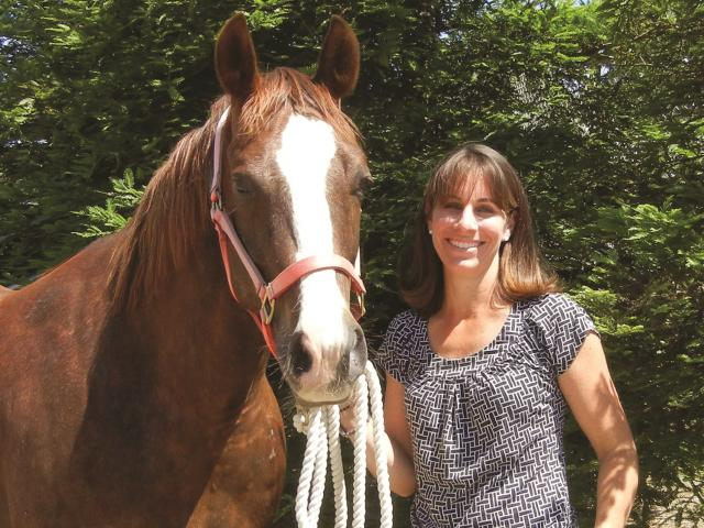 Dr. Carrie Finno, CEH director, with horse